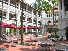Take a casual stroll in Raffles Hotel's courtyard