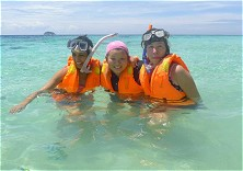 Happy snorkelers having a blast off our Tioman beach